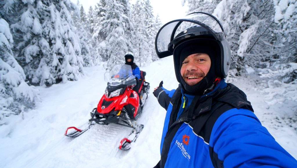 snowmobile finland happy traveller