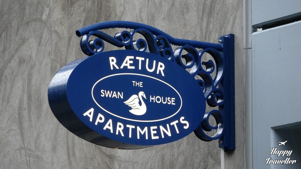 swan house reykiavik iceland happy traveller